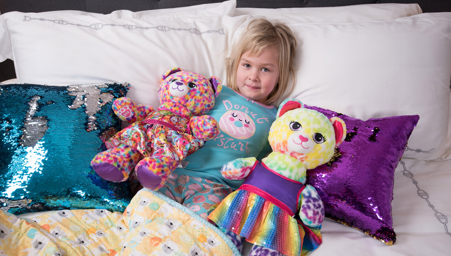 girl with animals and pillows
